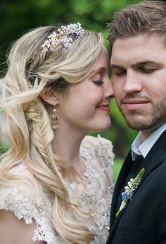 Brides.com: 21 Wedding-Ready Braids. Hidden Fishtail Braid  Here, the bride snuck in a delicate fishtail braid to add texture to classic romantic waves.  See more down wedding hairstyles.
