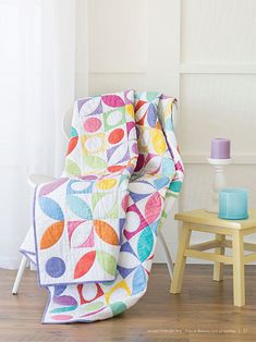 The Gumdrops quilt was featured in the Love of Quilting January February 2014 issue. Enjoy working with brightly colored fabrics - a great pattern for fat quarter quilts. The finished result is a surefire pick-me-up for winter's dreariest days.
