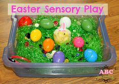 Easter Sensory Play with Easter grass and plastic eggs (and an adorable toy chick!)