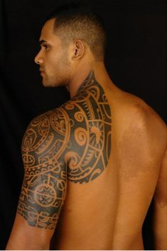 Black tribal tattoo on shoulders and arm - 55 Awesome Shoulder Tattoos | Art and Design