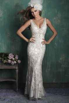 C352 Allure Couture Bridal Gown - Our signature slip gown is composed of soft charmeuse and a delicately beaded overdress.