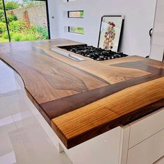 Absolutely stunning black walnut island made by @wildewodcreations. The worktop has been finished with @osmo_uk Polyx-Oil Clear Satin 3032 and we think it looks amazing! 😲