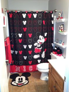 Mickey Mouse Bathroom this is the kids bathroom basically... when we update it I am putting in the shelves Dom already has the knick knack's for it... he is to old to put them in his room but still wants them out LOL