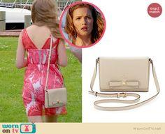 Emma's cream bow bag on Royal Pains.  Outfit Details: http://wornontv.net/35435/ #RoyalPains