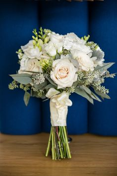 Beautiful and romantic bridal bouquet with touches of white and blush roses and plenty of greenery, make this a chic option for a spring wedding! #springwedding #weddingideas