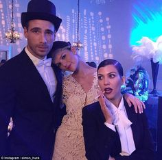 Party time: Kourtney didn't seem to let the fake cigarette leave her night all evening, just like her character Jay Gatsby