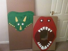 All ready for feed the T-Rex and pin the horn on the Triceratops! Boxes courtesy of ikea, drawings copied from Internet, used kids' poster paint and outlined with thick black marker. V simple and will double as props.