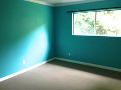 """The master bedroom """"Before"""" - very blue with mottled paint."""
