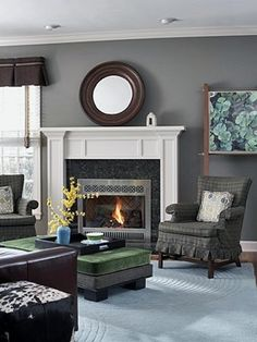 Beautiful wall color. Mirror above the fireplace is gorgeous!