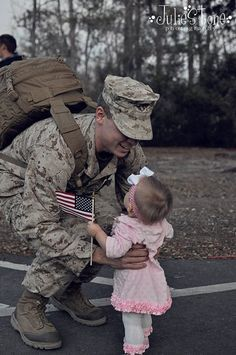 BEST feeling ever, a welcome home for a Daddy that has been so far away! GOD BLESS OUR TROOPS!