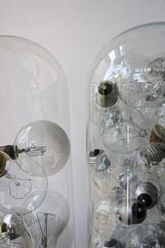 Light bulbs in glass cloche dome.