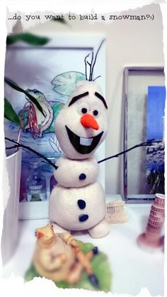 ...i got inspired from a pin...nailed it!:-)  diy Olaf socks---twigs for arms &  hair, felt fabric nose & mouth, velcro eyes &  teeth with real pebbles for buttons!:-D