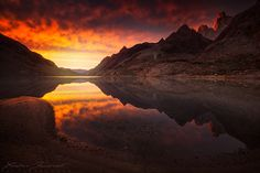 """La Playita.  """"From the deep and dark valley of Rio Electrico, a magic sunrise and stunning reflection of the Fitz Roy during my recent Patagonia trip. Fitz Roy, Patagonia, Argentina.""""  by Xavier Jamonet."""