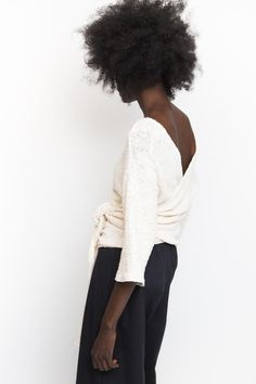 From Hackwith Design House, this cozy textured sweater wrap is great layering piece for fall weather. This long-sleeve sweater features a tie belt and revers...