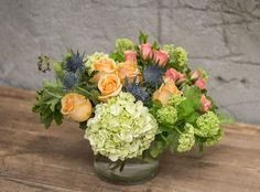Soft and sweet pastels.  http://shop.rogersgardens.com/browse.cfm/floral-arrangements/2,230.html