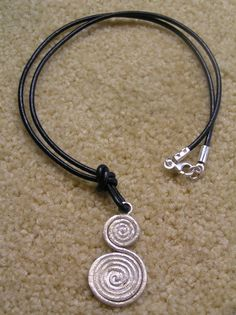 Double silver spiral pendant with leather cord by StoneSeeds on Etsy