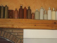Bouillotes cylindriques en grès ou en cuivre et brique pour chauffer le lit