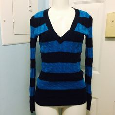 American Eagle Striped Sweater Cute, warm and snug, this is the perfect fall sweater to pair with jeans! Very flattering and deep v neckline :) American Eagle Outfitters Sweaters V-Necks