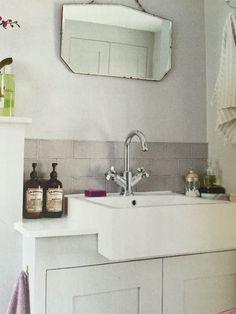 Bathroom clutter under sink - get countertop sink and cupboard underneath.  Nice grey tiles Laura 4dd0169be