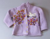 Girl's recycled needle felted sweater with lambs under plum trees. $150.00, via Etsy.