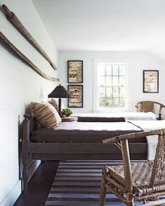 Salvaged oars hang above antique beds that came from a monastery.