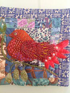 Bird  hand stitched and beaded, on Liberty fabrics.