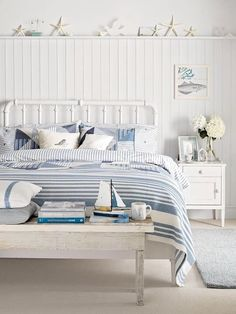 Love the white iron bed, crisp linens, and rustic bench.