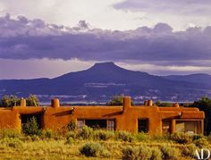 """The house, with Cerro Pedernal in the distance. """"I suppose I could live in a jail as long as I had a little patch of blue sky to look at,"""" O'Keeffe said. """"The kinds of things one sees in cities . . . it's better to look out the window at the sage."""""""