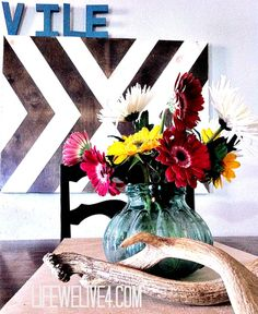 DIY Wooden Canvas Arrow Artwork--Eclectic , chic, and cheap wall art for the home!