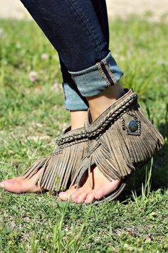 She's a keeper! The Olivia Wilde sandal should definitely get an award this summer! Leather fringe flows down the ankle, over a canvas material upper and kept tidy with a woven-chain trim at the top. A fun buckle embellishment adds the perfect touch to the side, zip her up the back and you're off!  #southernfriedchics