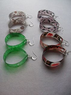 Recycled Bottle Earrings- Super Easy & Quick!    A 2-liter clear plastic bottle   Mod Podge   paintbrush   hole punch   scissors   ruler   marker- like a sharpie, for measuring   thin fabric, candy wrapper, food coloring, glitter, etc.     jump rings & ear wires