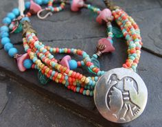 Thunderbird and Yucca Blooms Handcast Pewter, Glass and Copper Necklace. $49.50, via Etsy.