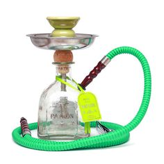 Product description:This is a custom Premium hookah made from a recycled Patrón Silver Bottle.Your Nube Nueve hookah kit will include:Assembled 750Ml Patrón Silver Bottle1 ceramic bowl   rubber fitting1 stainless steel charcoal tray1 Copper Pipe downstem1 pair of tongsMatching hose(s)2 assorted mouthpiece All necessary grommet(s)Nube Nueve Hookah's are created with the mission to inspire through the act of recycling and reusing. ♻ The quality of craftsm...