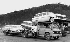 The '55 Fords are in, but what a strange, one-level, car hauler, doncha think!?