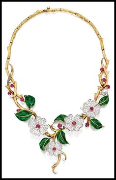 Necklace from gold, diamond, enamel, and ruby dogwood flower suite by Boucheron, Paris. Via Diamonds in the Library.