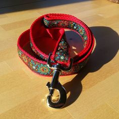 25mm Standard Lead on red cushioned webbing and Galaxy ribbon.