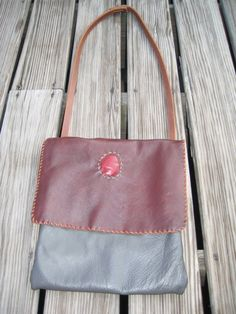 Men's messenger bag of recycled leather.