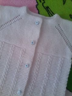 Top-down raglan, garter stitch, faux cable with eyelet