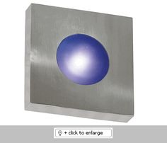 "Burst Large Square Wall Sconce    *Aluminum *Can Be Wall or Ceiling Mounted *Indoor or Outdoor Use    Glass/Shade: Cobalt Blue and White Opal Glass Included    UL Listed  Dimension: H. 4-7/8"", W. 10"", Ext. 10""    Bulb: 1-75 Watt (JDE11) Bulb Included    Finish: Polished Aluminum Finish, Black Finish  Regular price: $158.00  Sale price: $134.50"