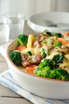 Cheesy Sausage & Veggie Bake- an easy dinner that I know my family will eat. I sometimes add cubed day-old bread as a topping as well to give some extra crunch. Veggie Casserole, Veggie Bake, Vegetable Bake, Broccoli Casserole, Sausage Casserole, Pork Recipes, Cooking Recipes, Healthy Recipes, Cheap Recipes
