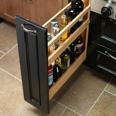 Base Liter Pull-Out - The roll-out bottle drawer is the perfect place for all your favorite oils, cooking wines, or other tall bottles up to...