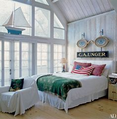 A light filled master bedroom with white washed wood walls | archdigest.com