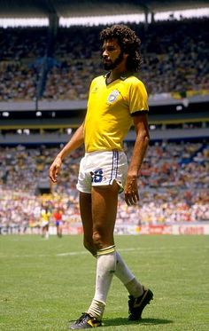 Socrates of Brazil takes a rest during the World Cup match against Spain at the Jalisco Stadium in Guadalajara Mexico Brazil won the match Brazil Football Team, Best Football Players, Football Is Life, World Football, National Football Teams, Soccer Players, Soccer Pro, Soccer Guys, Soccer Stars