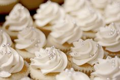 white cream cheese frosting with silver balls - easy and could tie in your silver color