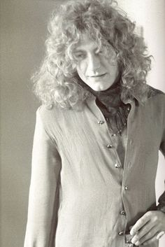Robert with a shirt buttoned up... pretty rare