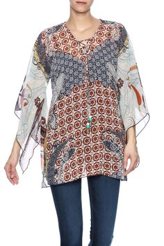 Multi print boho blouse with 3/4 asymmetric sleeves and a v-neckline.  Cassidy Tunic by Mesmerize. Clothing - Tops - Blouses & Shirts Clothing - Tops - Long Sleeve Florida