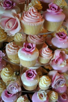 Gorgeous wedding cupcakes with sugar and natural roses, topped with a mixture of buttercream and fondant to add texture to suit all tastes.