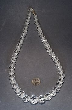 Graduated rock crystal bead necklace .  Beads vintage 1950s, incredible quality, in good condition, a silver clasp. Authentic box has wear.  Diameter of beads from 8.3mm to 15.5mm  Necklace length . . . . . . . 53 cm ( 20.8 inches)  Weight . . . . . . . 97 grams Before make a purchase, please read the rules of our shop please.  Enjoy your shopping!  Please visit my etsy Shops for vintage Christmas decorations. www.etsy.com/shop/VintageGentleOwl?ref=hdr_shop_menu  Yours faithfully, Olga.