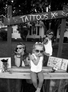 Stick on tattoo booth! Forget lemonade stands.. This would be great at an adult/kid party! Kids would love it.