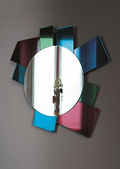 GLI SPECCHI DI DIONISO #6 design Ettore Sottsass | Collection of 6 wall mirrors in different shapes and sizes characterizes by polychromatic frames composed of elements in laminated coloured mirror, coloured laminated glass and lacquered glass.